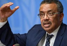 World Health Organization (WHO) Director-General Tedros Adhanom Ghebreyesus gestures during a press briefing on evolution of new coronavirus epidemic on January 29, 2020 in Geneva. (Photo by FABRICE COFFRINI / AFP)